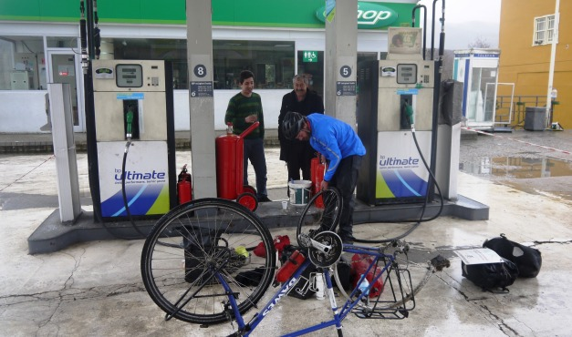 Fixing yet another puncture at a petrol station - but with the benefit of cay!