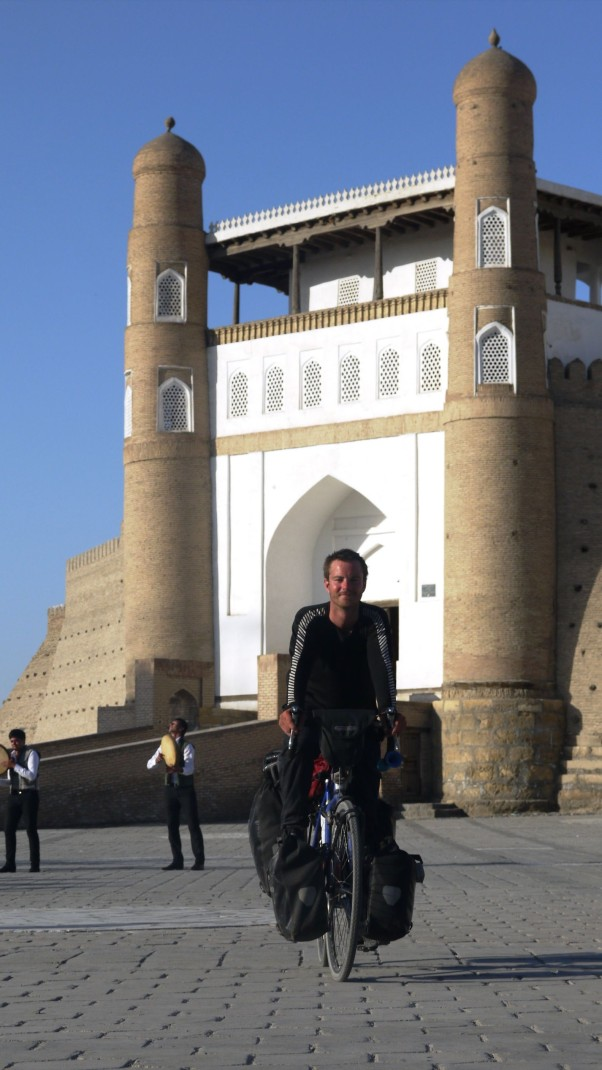 Cycling in front of Bukhara's Registan