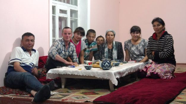 With my hosts for the night in Uzbekistan