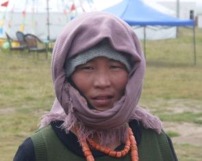 A Tibetan woman out in the marshland