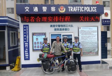 After being kicked off the G5 Highway these friendly officers insisted on getting dozens of pictures with me and the bike