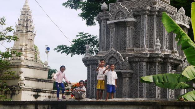 Children watch the parade from the temple wall...